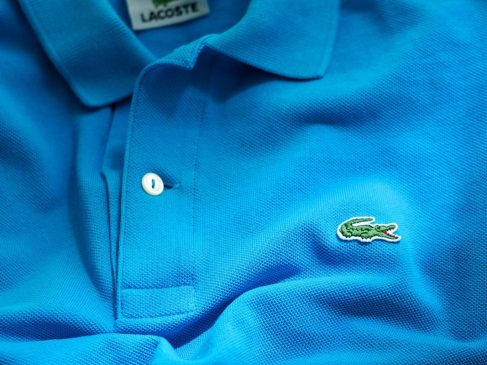 Why many are cutting brand logos off their clothes